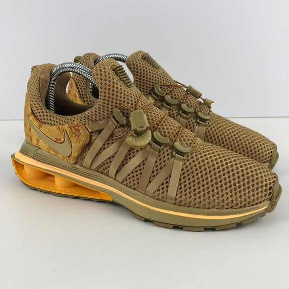 online retailer 2de1d 98913 Nike Shox Gravity Women s Metallic Gold Shoes 7. M 5b80b9b83e0caa2916e1087b